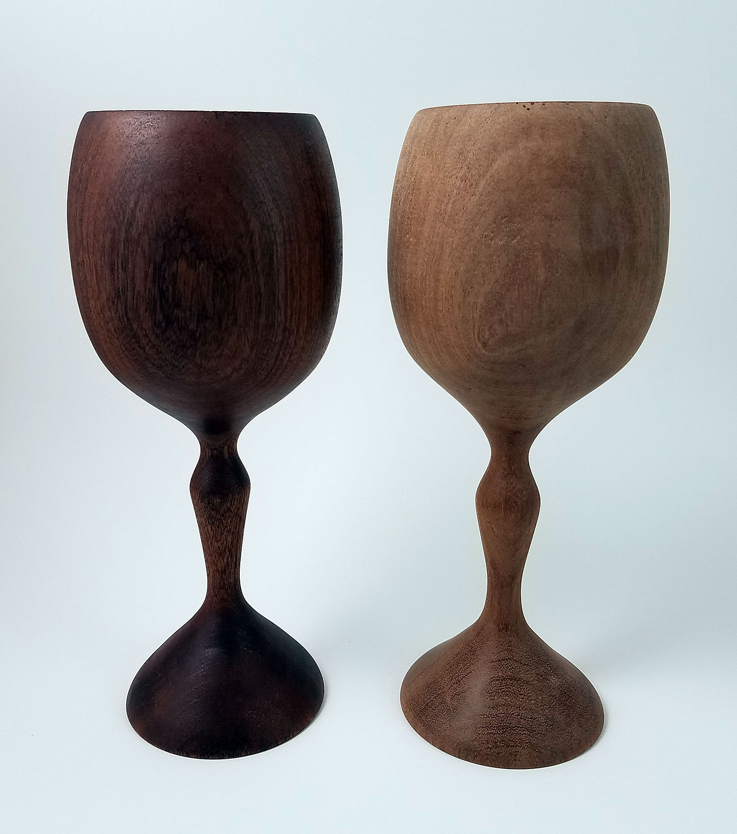 These two Sapele wood wine goblets are the same! The one on the right just hasn't had a finish applied yet. A little natural oil to lubricate the wood goes a long way!