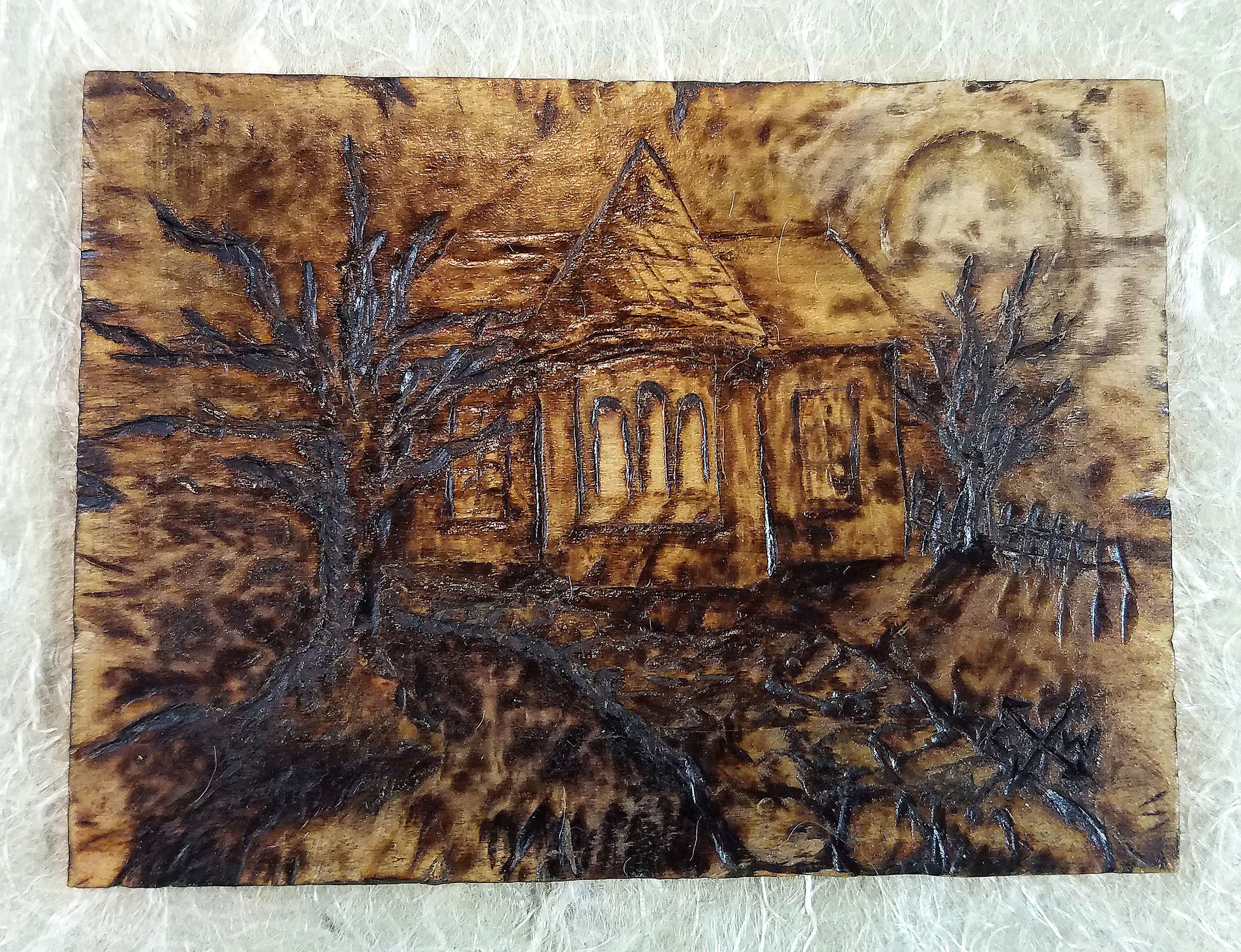 """Thoughts of Home"" - pyrography on Poplar plank mounted on handmade paper."