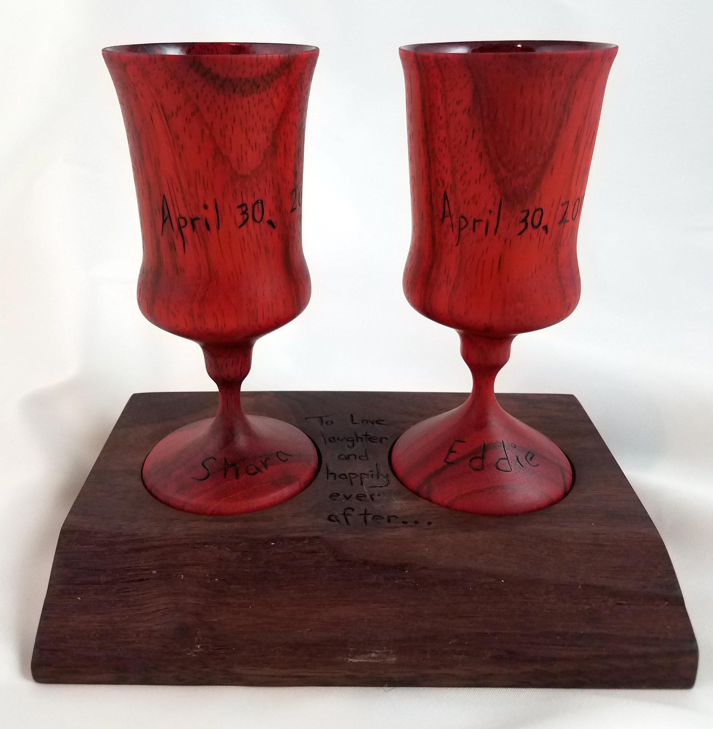 Padauk cordial glasses on Walnut base with wood burnt inscription.