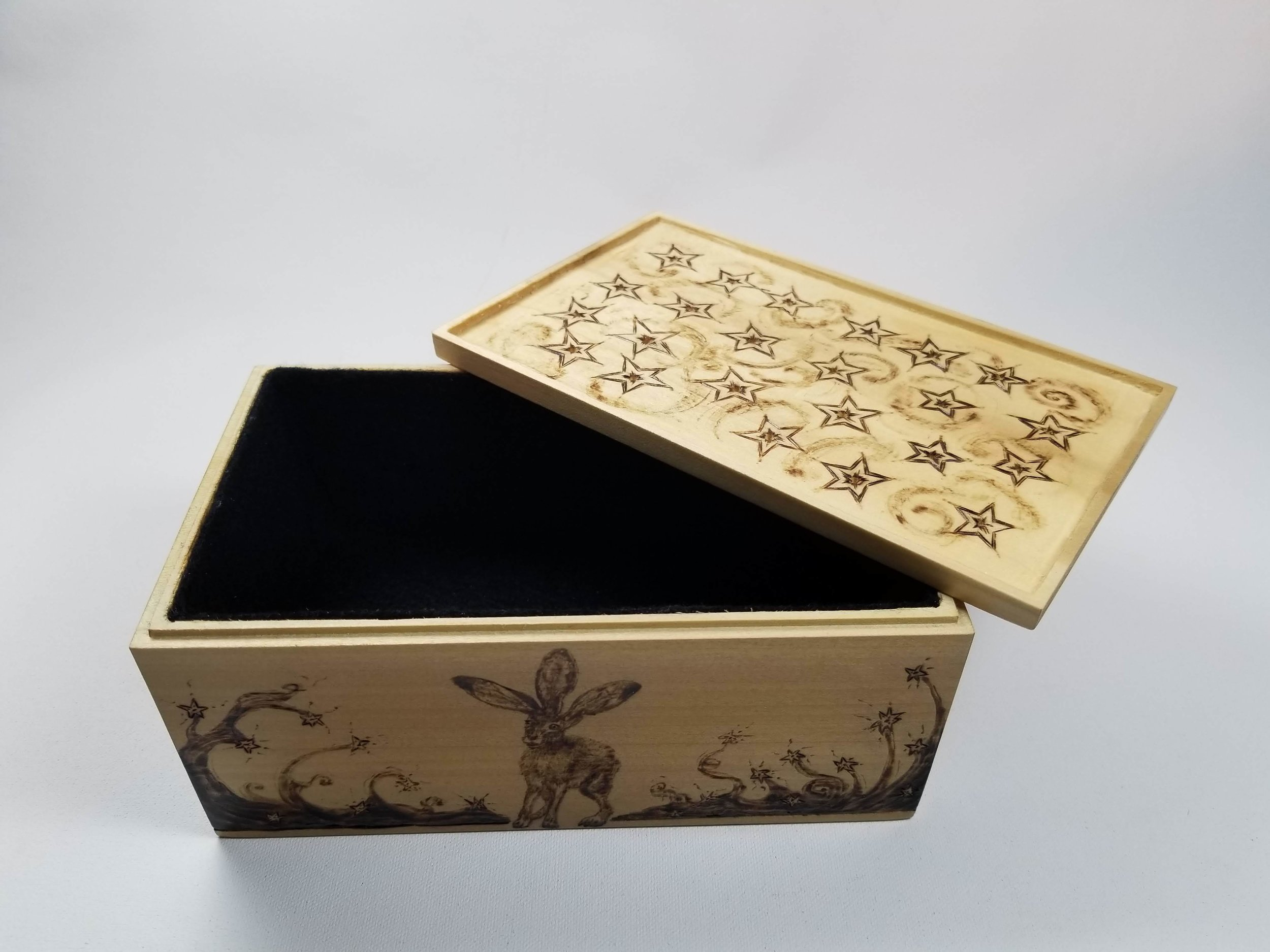 Hand carved Poplar wood box with felt lining showing stars on the underside of the lid.
