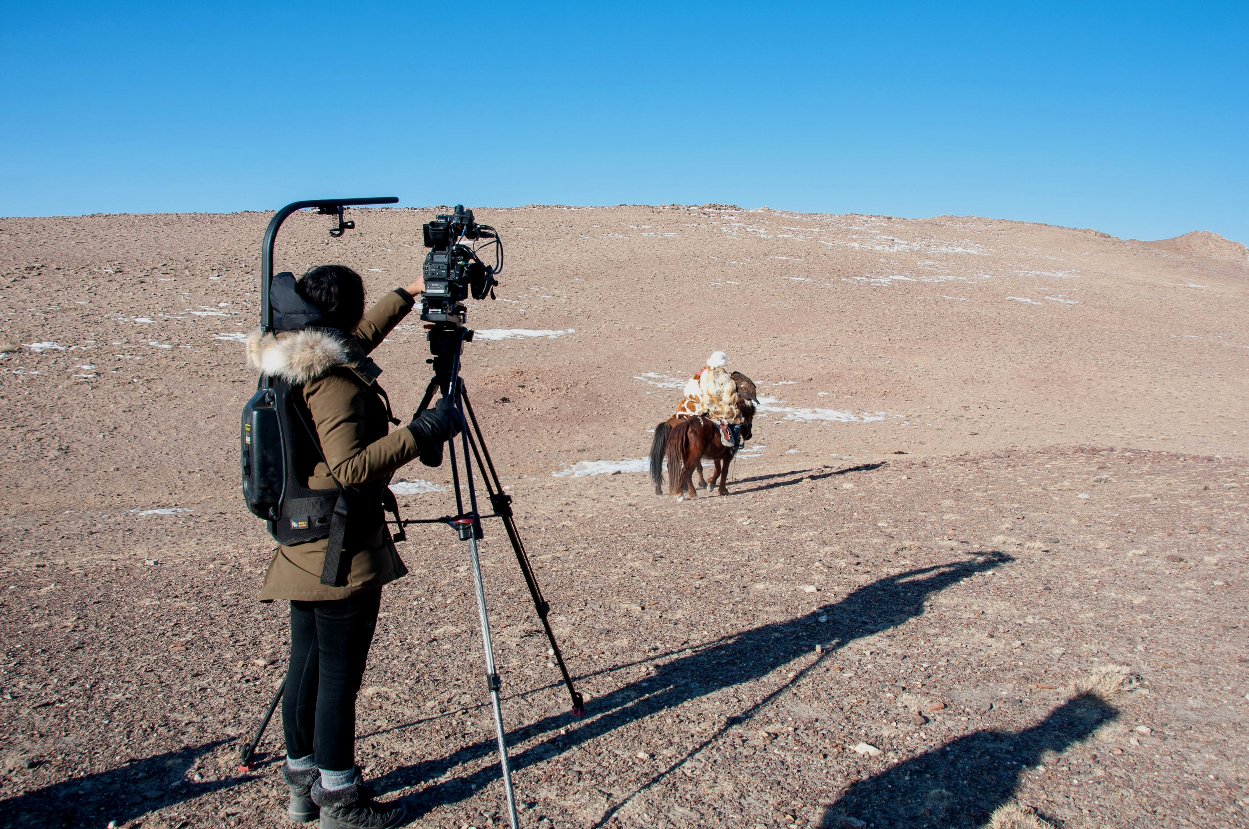 Filming with 13 year-old Akelik, an eagle huntress. Photo: Big Mongolia Travel