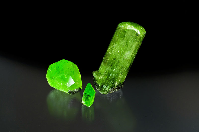 Fine diopside crystals. Merelani, Tanzania, the largest being 5.5 cm.