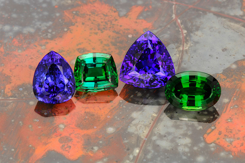 Pala International's gems from Tanzania: (from left to right) tanzanite, tsavorite, tanzanite, and chrome tourmaline.