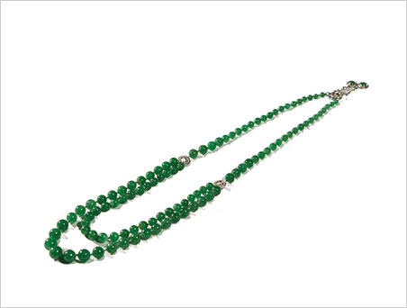 Not only are the jadeite beads beautiful, the necklace's clasp features two diamond and jadeite drops. (Photo: Grogan & Company news release via ArtfixDaily)