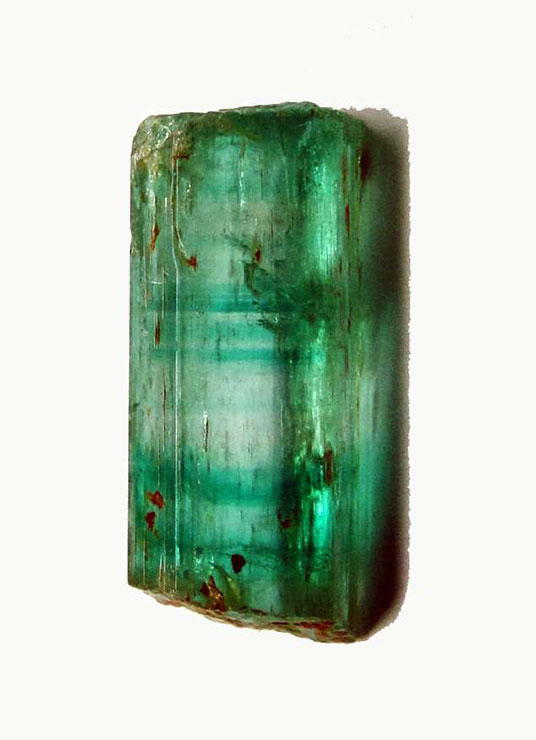 Figure 3.  Emerald crystal from Torrington (NSW) showing sharp, basal, colourless and green colour zones, in a typical sequence of bands of variable thickness. Weight 7.08 ct, length 17.50 mm. (Photo by the author)