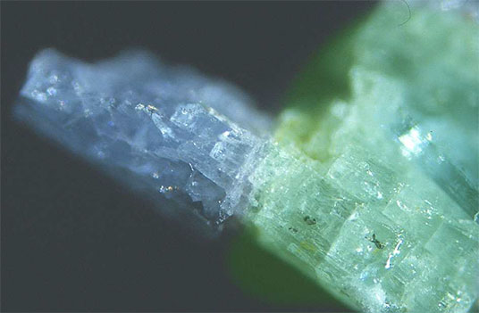 Figure 7.  The most outstanding of all green and blue beryl single crystals from the Binn Valley finds. Total length approximately 8 mm. Emerald and aquamarine? (Photo: M. Krzemnicki)