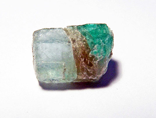 Figure 8a.  Bi-coloured Habachtal beryl specimen, consisting of an emerald top and a milky base (due to inclusions), separated by a mica layer. Weight 4.99 ct. (Donation G. Grundmann)