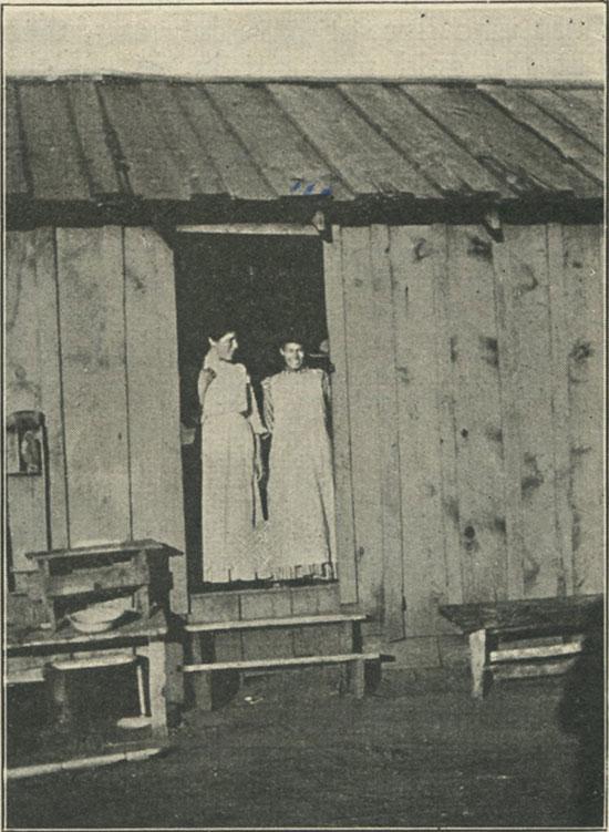 Mountain girls at cabin door