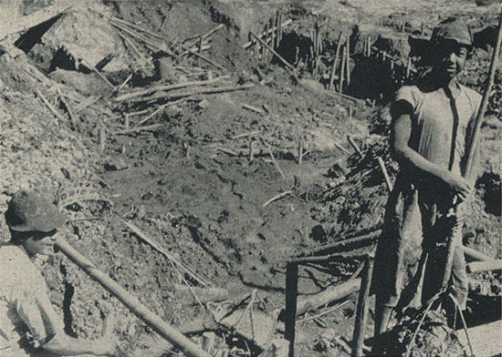 Alluvial diggings in the Burma gem mines, usually operated by two men. This image, in color, also is included in   Ruby Mines of Mogok – Slide Show   (image #11)