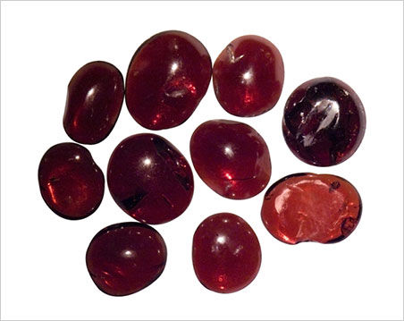 Roughly cabochon-cut garnets recovered from the 1,000-year-old Cirebon wreck. (Photo: Ken Scarratt)