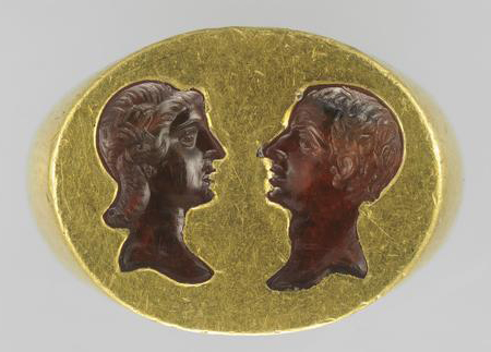 Ring with a Double Portrait  , 200–300 C.E., Roman. Cornelian intaglio and gold. Object (ring): H: 1.8 x L: 2.1 cm (11/16 x 13/16 in). Object (intaglio): H: 1.4 x L: 1.9 cm (9/16 x 3/4 in). Bibliothèque nationale de France, Département des monnaies, médailles et antiques, Paris.