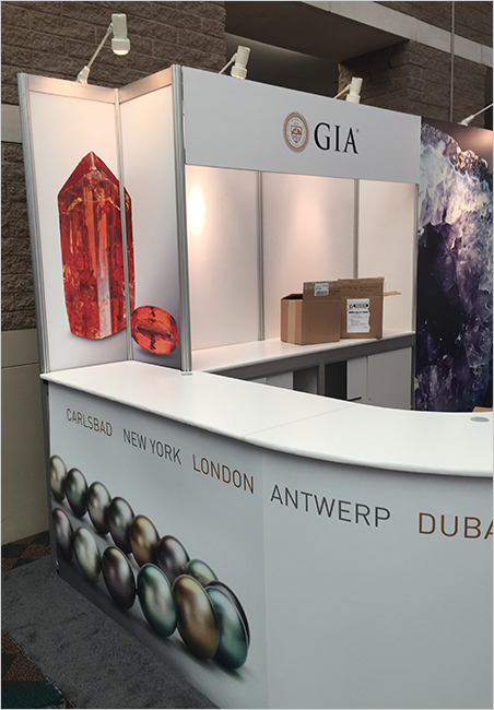 On loan.   The GIA booth at AGTA GemFair features images of crystals from the collection of Bill Larson, such as the lovely imperial topaz crystal, above left. (Photo: Bill Larson)