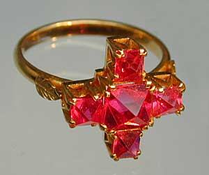 This Burmese spinel ring features  nat thwe  spinel octahedra, which have received only light polishing. (Photo:   John McLean   ; Ring:   William Larson Collection  )