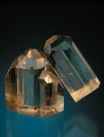 Magnificent intergrown brown topaz crystals from the Mogok region of Burma. 8.5 cm. high. (William Larson collection. Photo: Jeff Scovil)