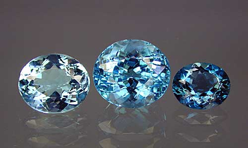 Three different examples of treated blue topaz. Gems: Pala International. (Photo:    Wimon Manorotkul  )