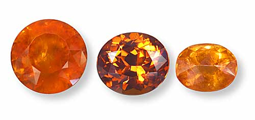 These three gems illustrate the three most important sources of spessartite garnet. From left, a mandarin garnet from Namibia, a spessartite from Nigeria, and a spessartite from the Little Three mine at Ramona, CA. (Photos: Wimon Manorotkul)