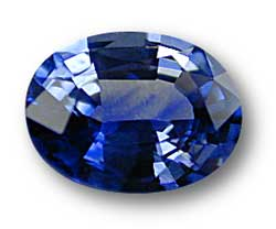 Color can also be influenced by color zoning, an unevenness of color. The oval sapphire above shows moderate color zoning. Moderate to severe color zoning does impact quality, and thus price. Color zoning is always judged in the face-up position, in an 180° arc from girdle to girdle, with the gem rotated through 360°. Color irregularities visible only through the pavilion generally do not impact value. Photo: Wimon Manorotkul