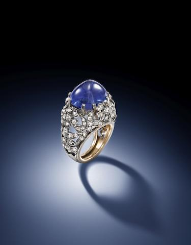 Sapphire and diamond ring, ca. 1925. The sugarloaf cabochon weighs 21.27 carats, within an openwork mount of stylised floral and foliate design, decorated with rose-cut diamonds, mounted in silver and gold. (Photo courtesy Bonhams)