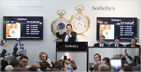 Do I hear 25 complication—er—million?  Tim Bourne auctioneering the Henry Graves Supercomplication on November 11. (Photo: Sotheby's news release)