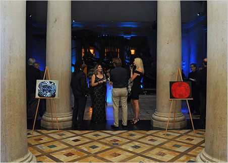 Eloïse Gaillou, Associate Curator of Mineral Sciences at the Natural History Museum of Los Angeles County, center, talks with guests just outside the museum's foyer, which was bathed in blue for the gala that welcomed the Blue Moon Diamond. The image on the right shows the diamond phosphorescing a strong orange-red. Most blue diamonds phosphoresce blue, so this places the Blue Moon in a category occupied by the Hope and Wittelsbach-Graff diamonds. Gaillou's research  focuses on diamonds and opals. (Photo: Tiffany Arnolds © for NHMLA)