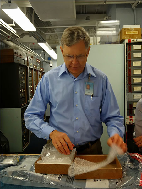 Jeffrey Post, Curator-in-Charge of the Smithsonian's Mineral Collection, unpacks the Blue Moon Diamond prior to testing in the Institution's highly secure Blue Room. (Photo: Eloïse Gaillou)