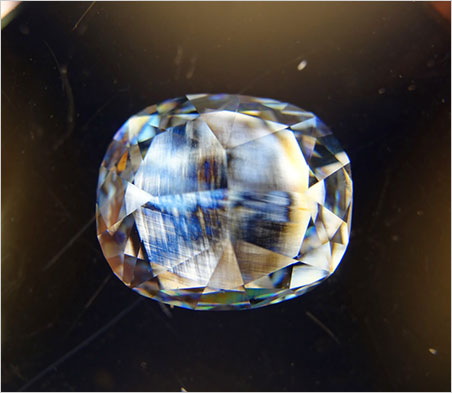 From Eloïse Gaillou: Finally, we were curious to look at the remaining strain inside the diamond structure. All natural diamonds show some strain features, and the Blue Moon is no exception. The colored striations are the evidence of such a strain. (Photo: Eloïse Gaillou, in between cross-polarizers)