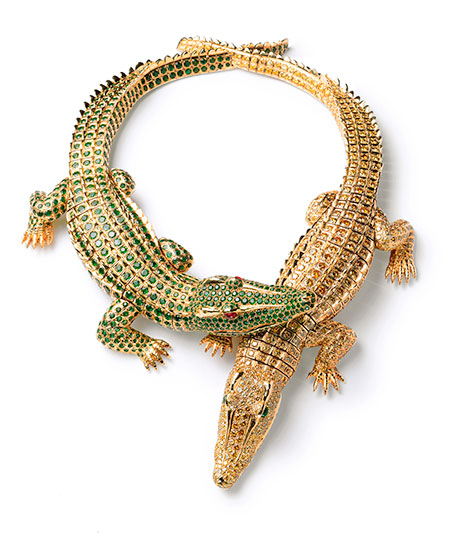 Crocs. Crocodile necklace worn by Mexican actress María Félix (1914–2002), pictured below, who eschewed Hollywood yet made films with everyone from Miguel Zacarías and Fernando de Fuentes to Jean Renoir and Luis Buñuel. The necklace is completely articulated, crafted from gold, two ruby cabochons, 1,023 yellow diamonds (60.02 tcw), and 1,060 emeralds (66.86 tcw), measuring 30 cm and 27.3 cm in length. When worn as a brooch, the tucked-in legs of each segment are replaced. It is said that Félix dropped off her own pet crocodile to serve as model, but cautioned that her baby was growing. It took two years to create the necklace. Cartier Collection. (Photo: Nick Welsh, Cartier Collection © Cartier)