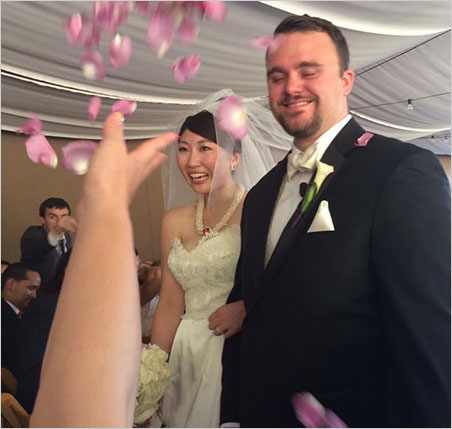 Bride and Groom. Rika and Will are pelted with petals as they exit the wedding tent. (Photo: Keiko Hayakawa)