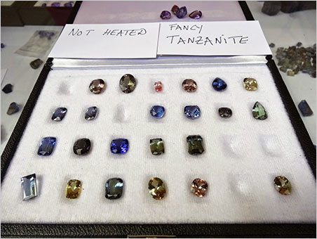 Au naturel. Some unheated colorful tanzanite faceted gemstones. They come in all colors, the pink and purple ones being the rarest. Seen at Valerio Zancanella's booth. (Photo: Eloïse Gaillou)