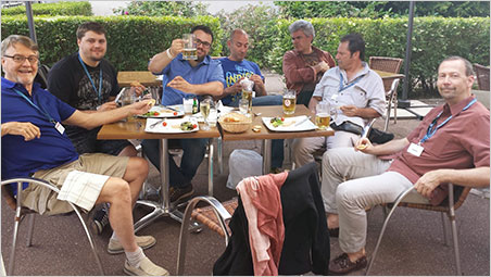 À votre santé.  Will Larson raises a beaker of gluten-free ale surrounded by family and friends: Bill Larson, Carl Larson (Toastmaster), Malte Sickinger, Marcus Walter, Mark Kaufman, and George Hickox. No doggy bag needed for the foie gras. (Photo: Eloïse Gaillou)