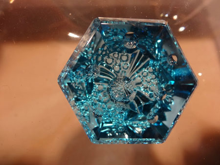 """Recto/verso. Okay, blue topaz is supposed to be a kind of a joke in the industry; a dime a dozen. But all kidding is shoved aside in the hands of a lapidary with vision. From the Somewhere In The Rainbow collection. Gaillou: """"They have some of the most amazing rare gemstones I've even seen."""" (Photo: Eloïse Gaillou)"""