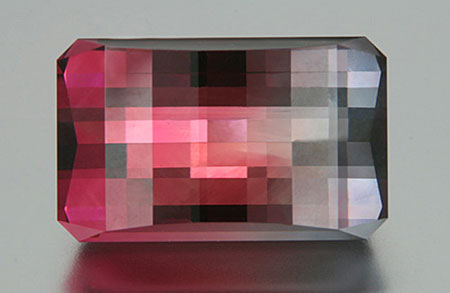 An example of inventive faceting: a  bicolor tourmaline cut by J. L. White Fine Gemstones. (Photo: Jeff White)