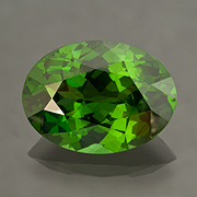 Envious?  Zircon comes to us in a rainbow of hues, often colorless, golden, or ruddy. This natural green variety is more rare. Inv.  #20069 . (Photo: Mia Dixon)