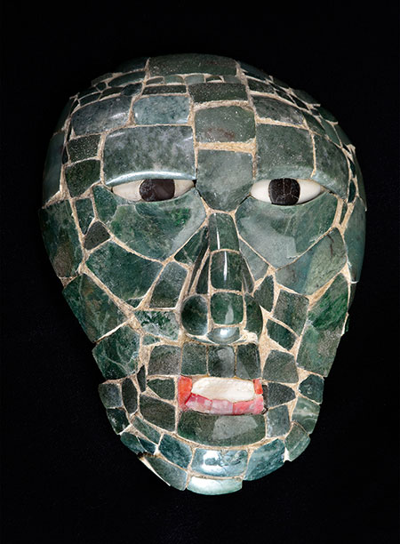 This  mask  was found in the tomb of Great Scrolled Skull, a ruler of Santa Rita Corozal in Belize during the Early Classic period (250–900 C.E.). A symbol of power, Great Scrolled Skull probably wore it as an ornament on his belt or on a necklace. The mask's jade, shell, and obsidian were attached to an organic backing that had decomposed, so when it was found, it was a pile of chips that had to be reconstructed. For more on Maya jadeite, see this  profile of work by George E. Harlow, curator of the American Museum of Natural History. (Image courtesy of the National Institute of Culture and History and Science Museum of Minnesota)