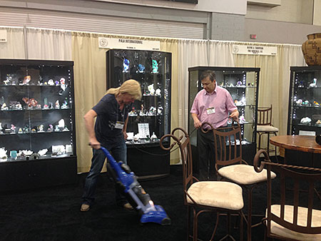 You missed a spot. Pala boothmates Wayne A. Thompson (of  Ikons fame) and Alain Martaud tidy up the place a bit. It's a dirty job, but someone has to do it—and to supervise—and document. (Photo: Will Larson)