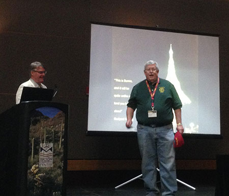 """Warming up the crowd. Paul S. Harter, right, prominent mineral collector and chair of the 60th Tucson Gem and Mineral Show, introduces Bill Larson before Bill's Valentine's Day presentation on """"The Gem and Crystal treasures of the mythical Valley of Mogok."""" (Photo: Will Larson)"""