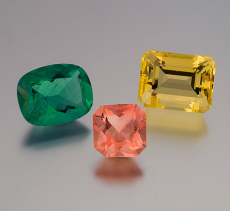 Triple Play. Green, 9.25 ct, 14.7 x 11.7 x 7.5 mm from the UK; orange, 5.30 ct, 10 x 10 x 7 mm from Switzerland; yellow, 14.22 ct, 14.6 x 11.2 x 9.9 mm from France. As explained in the Pulse, fluorite can be quite affordable, yet it's often overlooked. (Photo: Mia Dixon)