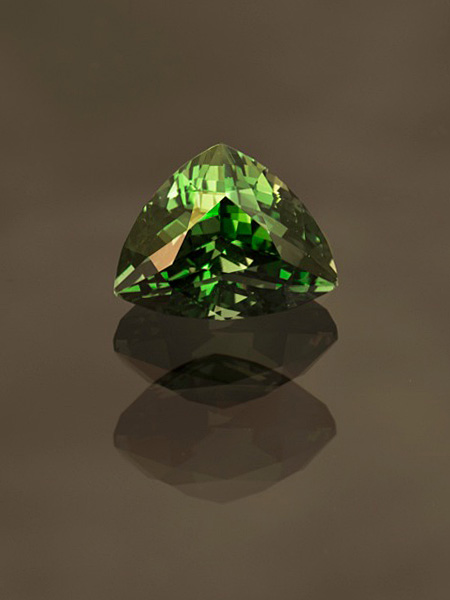 A  natural vanadium-bearing chrysoberyl , from the  inventory of Pala International, illustrates the allure of this rare gemstone material. From Tanzania, 3.05 ct, 9.67 x 8 x 8 mm. (Photo: Mia Dixon)