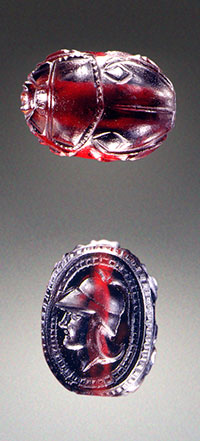 This  pyrope scarab (13.3 × 9.4 mm), gem no. 1, is the earliest dated and only Etruscan garnet in the present study (late 4th–3rd century BCE). The flat side is engraved with a helmeted head in profile. While the scarab shape is characteristic of Etruscan glyptic, the use of garnet as a carving material is rare. Inv. no. 81.AN.76.142, J. Paul Getty Museum, Villa Collection. (Photo: Ellen Rosenbery)