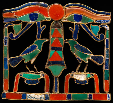 Pectoral with Birds Flanking an Ukh Symbol. Gold, inlaid with carnelian, turquoise, lapis lazuli. H. 3.9 cm (1½ in.), W. 4.2 cm (1-5/8 in.). Twelfth Dynasty, probably reign of Senwosret II or Senwosret III (ca. 1887–1840 B.C.E.). The Manchester Museum, The University of Manchester (5966). (Photo: Anna-Marie Kellen)