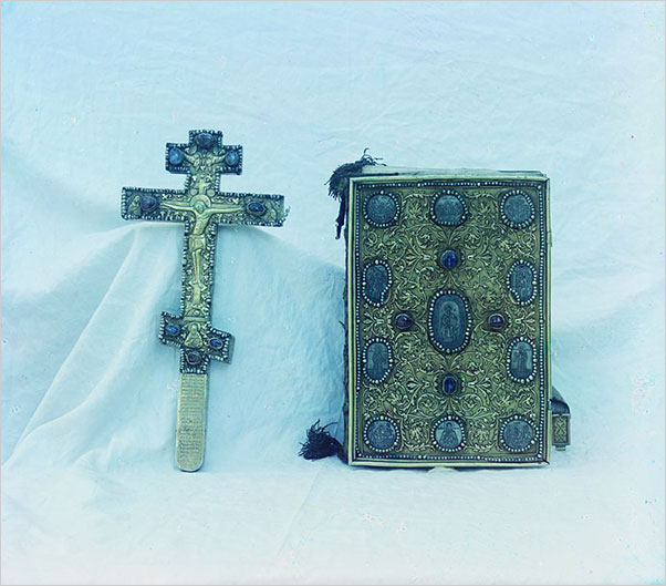 Cross and Gospel. Gift from Czar Mikhail Feodorovich (1596–1645). In the vestry of the Assumption Cathedral in the Kremlin, 1911. Following the 1917 revolution, churches across Russia had their holdings transferred to the Soviet treasury. (Photo: Prokudin-Gorskiĭ, Sergeĭ Mikhaĭlovich, 1863–1944)