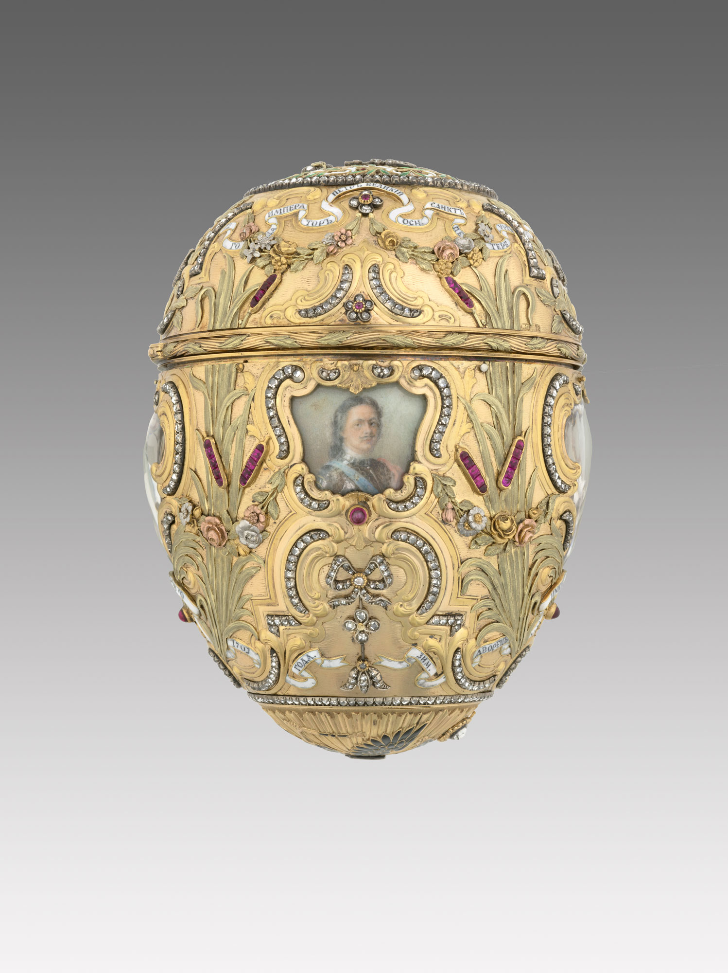 Carl Fabergé (1846–1920), Fabergé workshop, Mikhail Perkhin (workmaster).  Imperial Peter the Great Easter Egg , 1903. Egg: gold, platinum, silver gilt, diamonds, rubies, enamel, watercolor, ivory, rock crystal. Surprise: gilt bronze, sapphire. Egg: 12 x 7.9 cm, Surprise: 4.7 x 6.9 cm, Stand: 7.7 x 6.9 cm, Virginia Museum of Fine Arts, Bequest of Lillian Thomas Pratt. This was featured in  Faberge, Jeweller to the Czars  last year at the Montreal Museum of Fine Arts. (Photo courtesy The Montreal Museum of Fine Arts)