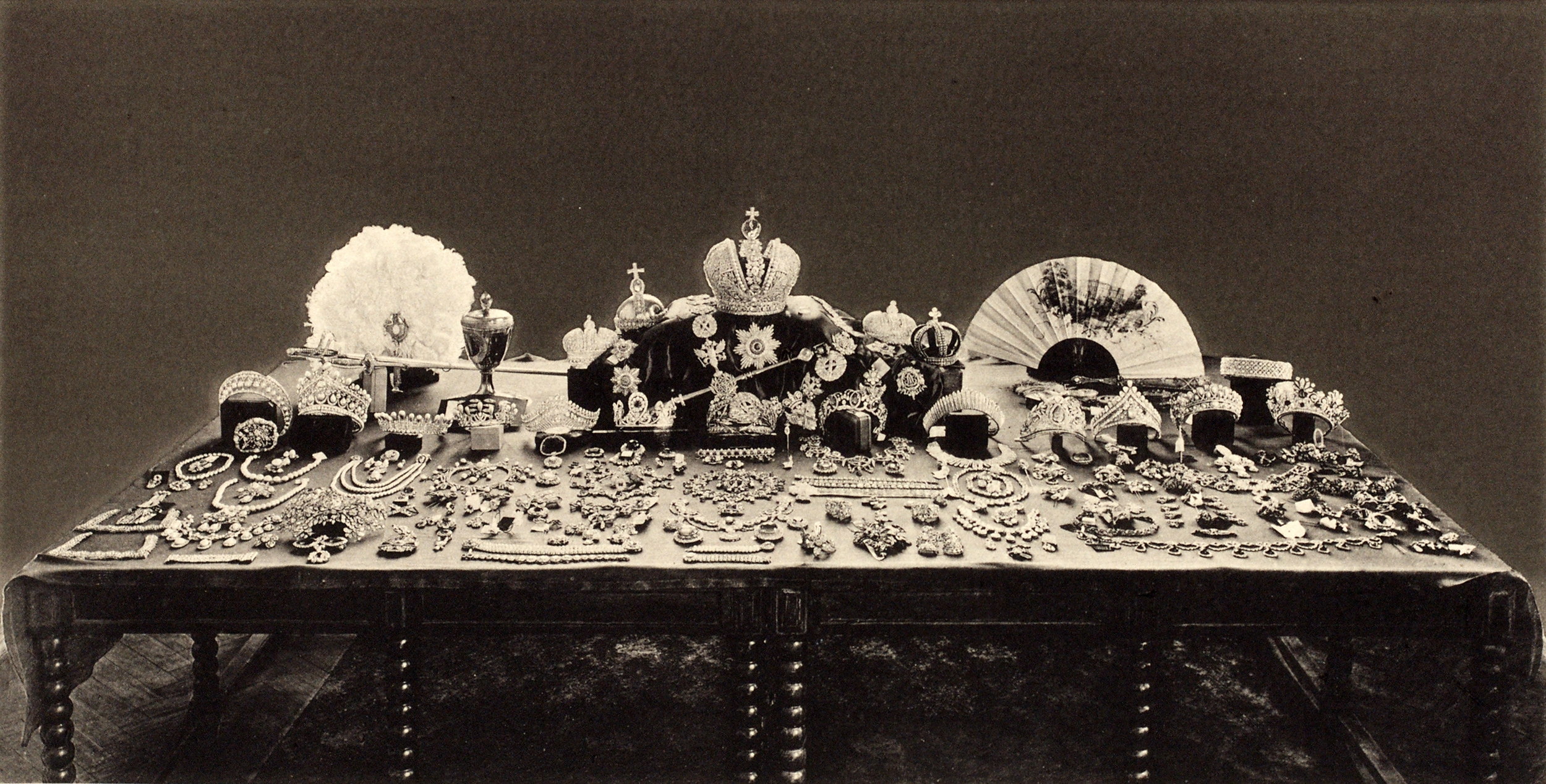 One-stop shopping?  This likely is the first photograph ever taken of the Russian crown jewels, from an album issued in 1922, and included in the collection of George F. Kunz, now at the U.S. Geological Survey Library. The album ostensibly was crafted to create interest amongst buyers. Or was it?  Click  for very large zoom. (Photo courtesy U.S. Geological Survey)