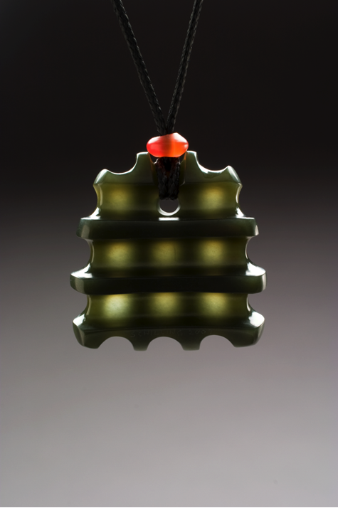 Another Peter Schilling pendant carved out of Wyoming olive jade.