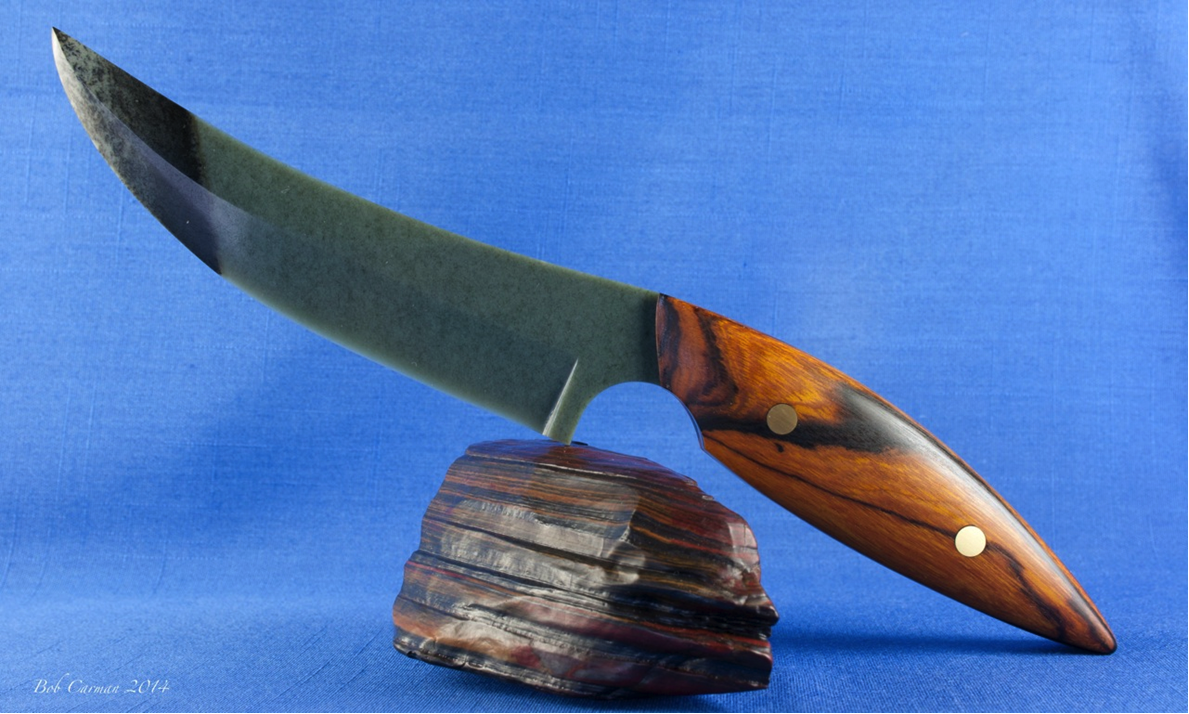Full tang Wyoming sage with dendritic rind nephrite blade fitted with desert ironwood scales shown about. This knife was also carved and photographed by Robert Carmen.