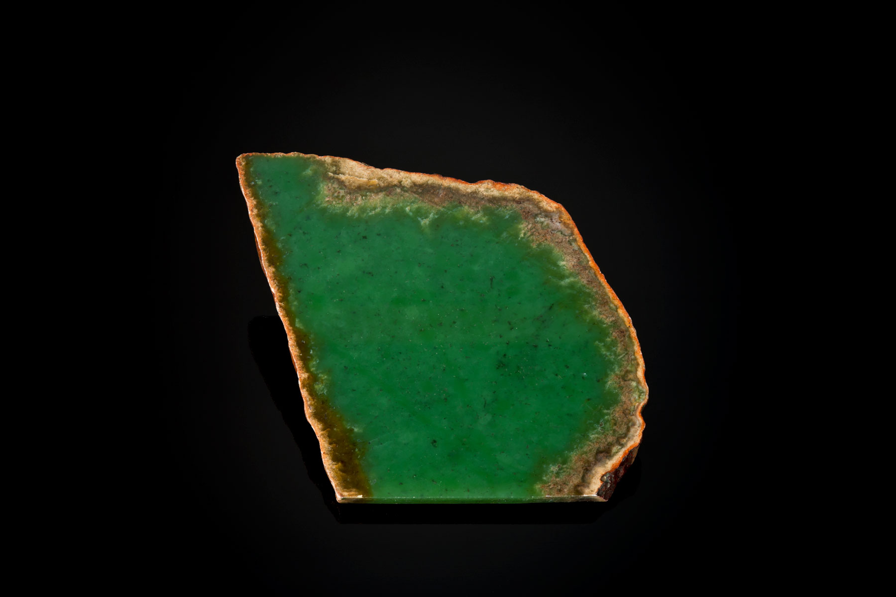 "This is one of the first pieces of good green that I purchased in 1980. I bought this piece from John Sinkankas, who had bought it in 1948 at a show. It is about 2"" x 5"" x ¼"".  (Photo: Robert Weldon)"