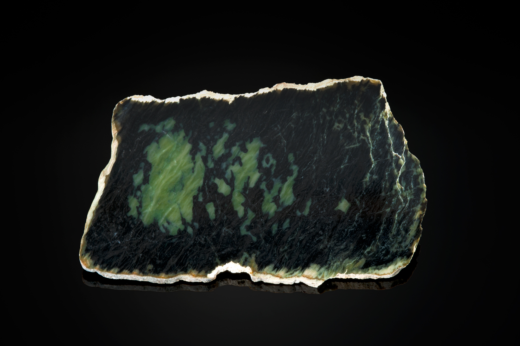 A piece of patterned jade is shown above that displays best in transmitted light.  (Photo: Robert Weldon)