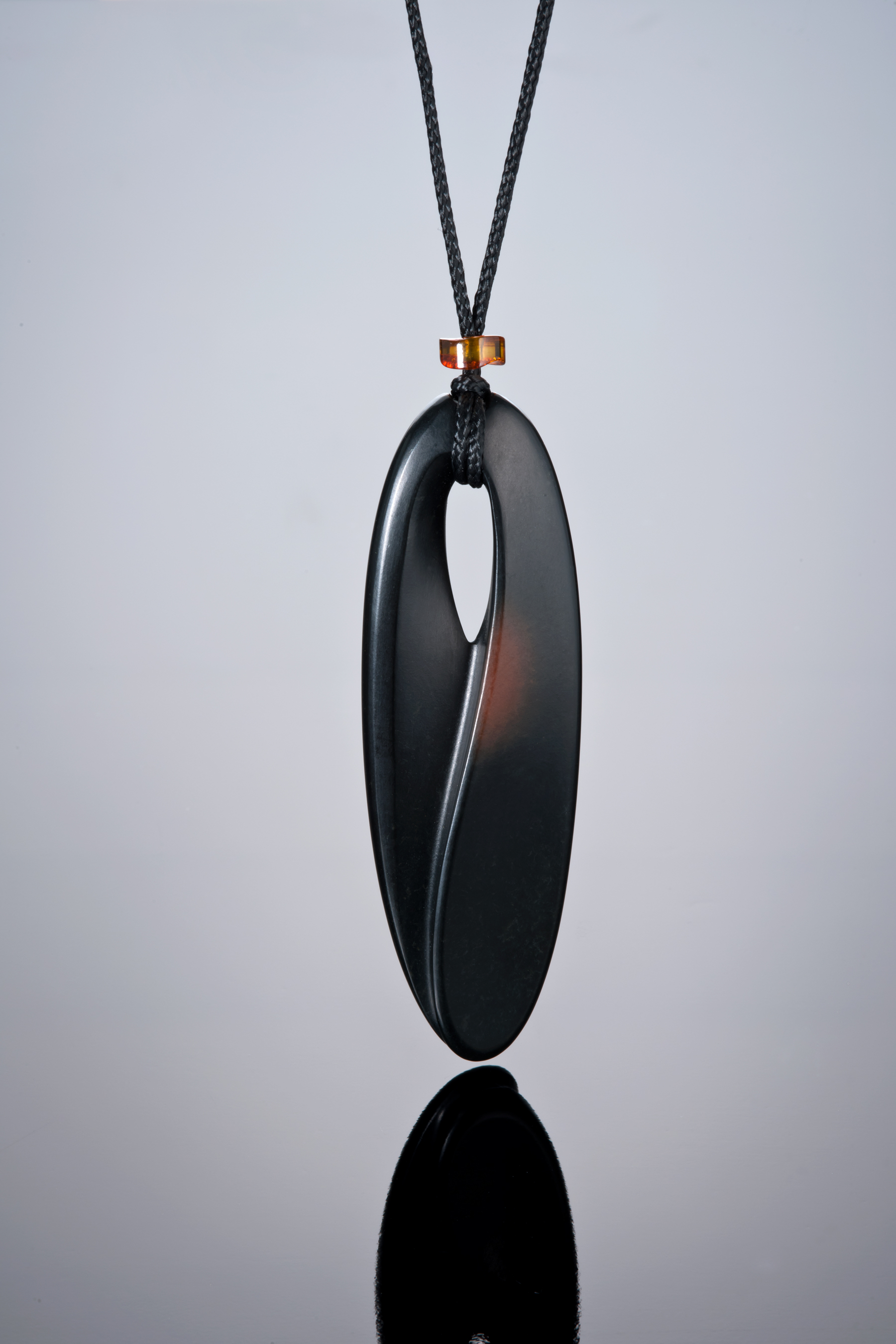 Above is a 3-inch pendant carved by Peter Schilling from Edward's black jade with some of the rind shown.  (Photo: Robert Weldon)