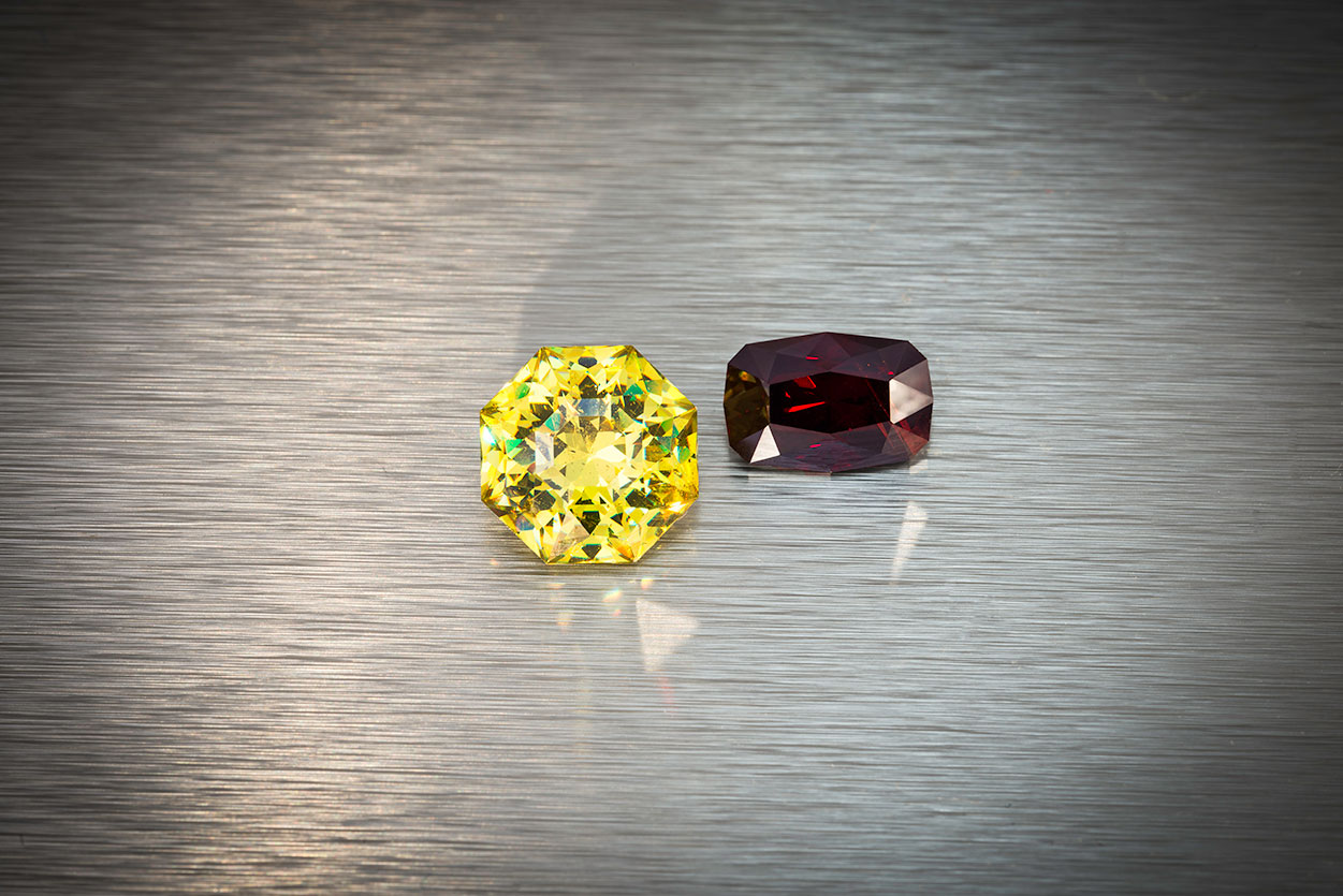 Cousins.  Left, sphalerite from Spain, 11.34 ct., 12.8 x 12.8 x 8.5 mm. Right, rare wurtzite from Mahenge, Tanzania, 5.81 ct., 12.4 x 8.3 x 6.2 mm. Both of these stones were custom cut by Brett Kosnar. Prices available upon request. (Photo: Mia Dixon)
