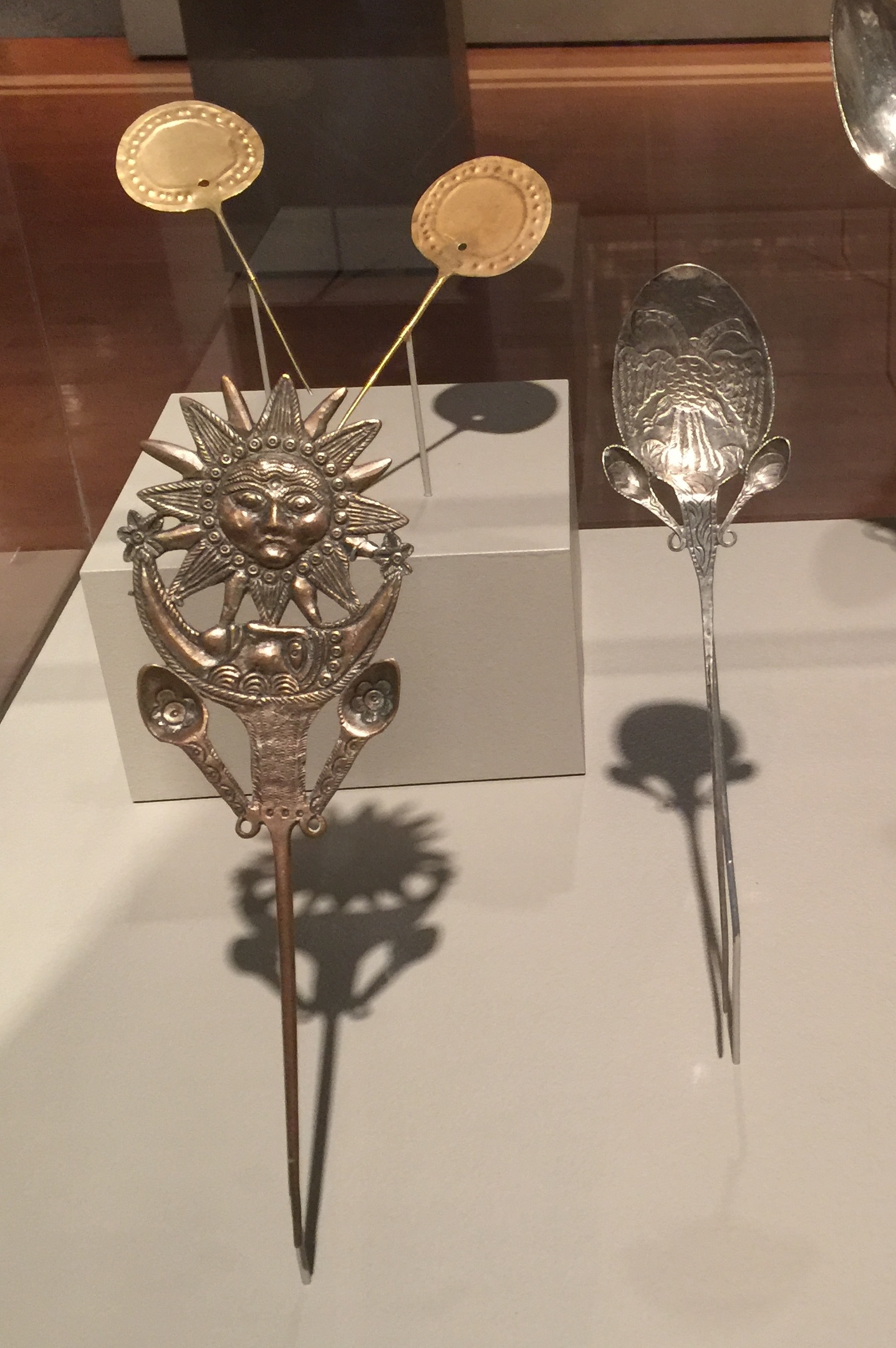 Upper left, pair of  tupu  pins, Inca, Peru, Chile or Bolivia, 1400–1500, gold. Anonymous gift, 1995.318.1 & 2. Lower left,  ttipqui  pin, Peru, 1800s, silver-plated copper. Gift of Mrs. LeRoy Schwartz, 1954.156. Right,  ttipqui  pin, Peru, 1800s, silver. Gift of Dr. Mary Lanius, 2008.844. (Photo: David Hughes)